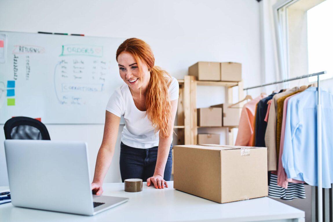 woman-parcel-laptop-scaled.jpeg